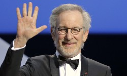 Director and jury president Steven Spielberg acknowledges applause during the opening ceremony ahead of the screening of The Great Gatsby at the 66th international film festival, in Cannes, southern France, Wednesday, May 15, 2013. (AP Photo/Francois Mori)