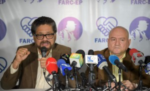 FARC commanders Ivan Marquez (L) and Carlos Lozada deliver a press conference announcing the launching of their political party in Bogota on July 24, 2017. The FARC guerrillas announced Monday they will launch a legal political party on September 1, after signing on November an agreement to overcome an armed conflict that lasted over half a century. / AFP / Raul Arboleda